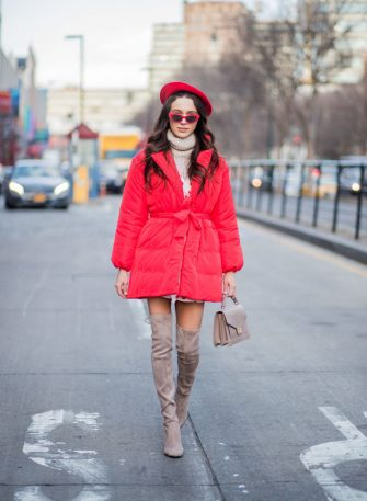 NEW YORK, NY - FEBRUARY 08: Mary Leest wearing red beret, turtleneck, red puffer jacket, overknees boots seen outside Creatures of Comfort on February 8, 2018 in New York City. (Photo by Christian Vierig/Getty Images)