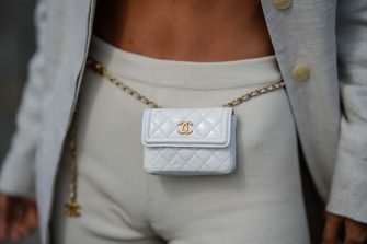 PARIS, FRANCE - AUGUST 01: Diana Batovkina wears beige cyclist shorts from Jacquemus, a white shiny quilted leather Chanel belt / small bag, a beige 12 Storeez blazer jacket, on August 01, 2021 in Paris, France. (Photo by Edward Berthelot/Getty Images)