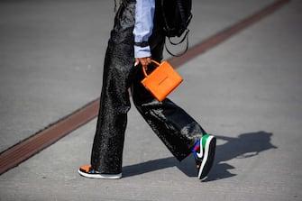 COPENHAGEN, DENMARK - AUGUST 11: A guest is seen wearing orange bag, black pants outside Mother of Pearl on August 11, 2021 in Copenhagen, Denmark. (Photo by Christian Vierig/Getty Images)