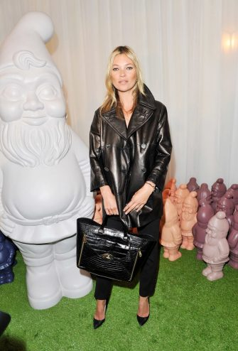 LONDON, ENGLAND - SEPTEMBER 18:  (EMBARGOED FOR PUBLICATION IN UK TABLOID NEWSPAPERS UNTIL 48 HOURS AFTER CREATE DATE AND TIME. MANDATORY CREDIT PHOTO BY DAVE M. BENETT/GETTY IMAGES REQUIRED)  Model Kate Moss arrives at the Mulberry Spring Summer 2013 Show during London Fashion Week at Claridge's on September 18, 2012 in London, England.  (Photo by Dave M. Benett/Getty Images)