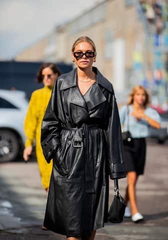 COPENHAGEN, DENMARK - AUGUST 08: Claira Rose Cliteur seen wearing black belted leather coat outside Baum und Pferdgarten during Copenhagen Fashion Week Spring/Summer 2020 on August 08, 2019 in Copenhagen, Denmark. (Photo by Christian Vierig/Getty Images)