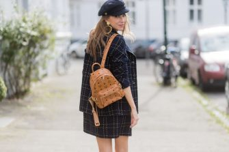 DUESSELDORF, GERMANY - AUGUST 5: Model and fashion blogger Alexandra Lapp wearing tweed dress and coat from Steffen Schraut, Balmain x HM sandals, Strak backpack by MCM, Chanel tweed cap, golden Chanel chains in form from Chanel coins, Chanel chocker and golden bracelet from Schubart Goldschmiede and golden vintage earrings with a peals by Chanel on August 5, 2017 in Duesseldorf, Germany. (Photo by Christian Vierig/Getty Images)