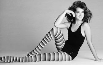 Brooke Sheilds models a pair of striped tights and a black leotard by Shogren Industries, Inc. Shields helped design this new line and will be featured in the advertisements for the full line of Shogren Industries.