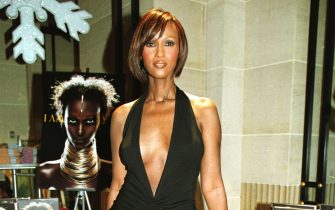 """397581 03: Supermodel Iman, who is also David Bowie's wife, makes an appearance November 20, 2001 at Henri Bendel in New York City to promote her new book, """"I Am Iman."""" (Photo by Diane L. Cohen/Getty Images)"""