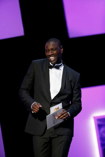 French actor Omar Sy arrives to unveil the Best Actress award during the 38th Cesar Awards ceremony on February 22, 2013 at the Chatelet theatre in Paris. AFP PHOTO / PATRICK KOVARIK        (Photo credit should read PATRICK KOVARIK/AFP via Getty Images)