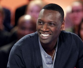 """French humorist and actor Omar Sy takes part in the TV show """"Le Grand Journal"""" on a set of Canal Plus channel, on February 7, 2012 in Paris. AFP PHOTO / PATRICK KOVARIK (Photo credit should read PATRICK KOVARIK/AFP via Getty Images)"""
