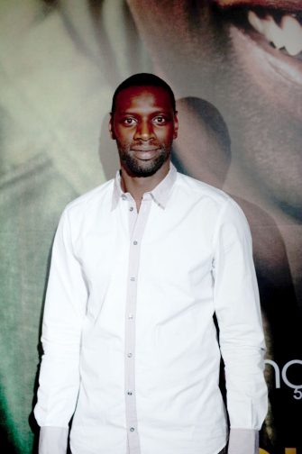 """PARIS, FRANCE - OCTOBER 18:  Actor Omar Sy attends the Paris premiere of """"Intouchables""""at Cinema Gaumont Marignan on October 18, 2011 in Paris, France.  (Photo by Trago/WireImage)"""