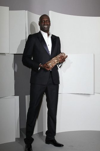 PARIS, FRANCE - FEBRUARY 24:  Actor Omar Sy poses in the Awards Room during the 37th Cesar Film Awards at Theatre du Chatelet on February 24, 2012 in Paris, France.  (Photo by Marc Piasecki/Getty Images)