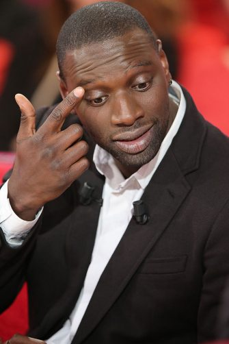 """French actor Omar Sy is pictured as he takes part in the TV show """"Vivement Dimanche"""" on December 5, 2012 on a set of French TV France 2 in Paris. AFP PHOTO THOMAS SAMSON        (Photo credit should read THOMAS SAMSON/AFP via Getty Images)"""