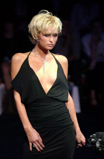 Model Paris Hilton wears a Wayne Cooper outfit  during a fashion parade at Federation Square Theatre in Melbourne 12 November 2003. The parade was part of the 2003 Australian Winter Autumn Fashion Week showcasing Australian designers to domestic and overseas buyers.  EPA/JULIAN SMITH AUSTRALIA AND NEW ZEALAND OUT