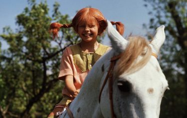 """TO GO WITH AFP STORY BY DELPHINE TOUITOU (FILES) A file photo taken 01 May 1969 shows a still from the movie """"Pippi Longstocking"""" with Inger Nilsson as Pippi on her horse, Little Gubben. Swedish writer Astrid Lindgren, who would have been 100 14 November 2007, still enjoys worldwide success with her children's books, which like her most famous character Pippi Longstocking do not seem to have aged a bit. Born 14 November 1907 in the southeastern Swedish town of Vimmerby, the writer revolutionized the world of children's books with such beloved characters as Emil of Maple Hill, Madicken, Karlsson-on-the Roof and Ronia the Robber's Daughter.  AFP PHOTO / Pressens Bild (Photo credit should read Pressens Bild/AFP via Getty Images)"""
