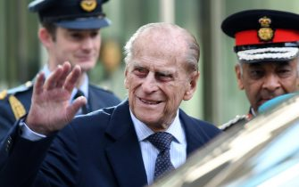Britain's Prince Philip, the Duke of Edinburgh waves to well-wishers after he and Britain's Queen Elizabeth II (unseen) officially opened the new Cyber Crime Security centre in London, Britain, 14 February 2017. ANSA/ANDY RAIN