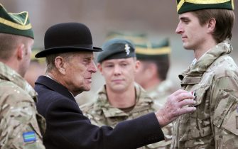 Britain's Prince Philip, Duke of Edinburgh (2-L) visits the tank regiment of the Queen's Royal Hussars in Paderborn, Germany, 19??November 2014. The British royal awarded soldiers who just returned back from south Afghanistan for their service.  ANSA/CAROLINE??SEIDEL