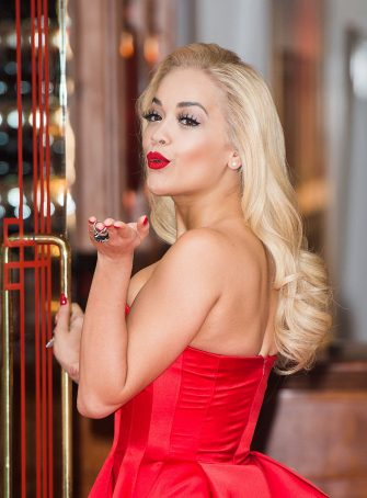 LONDON, ENGLAND - MARCH 19:  Rita Ora attends a photocall to celebrate 100 years of the Coca-Cola Contour Bottle at the Coca-Cola Contour Centenary Bar on March 19, 2015 in London, England.  (Photo by Samir Hussein/WireImage)