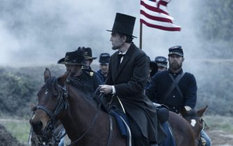 """""""LINCOLN""""  L 002611R  President Abraham Lincoln (Daniel Day-Lewis) looks across a battlefield in the aftermath of a terrible siege in this scene from director Steven Spielberg's drama """"Lincoln"""" from DreamWorks Pictures and Twentieth Century Fox.  Ph: David James, SMPSP  ©DreamWorks II Distribution Co., LLC. All Rights Reserved."""