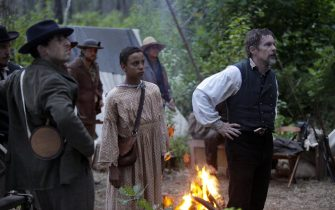 """(L-R): Joshua Caleb Johnson as Onion and Ethan Hawke as John Brown in THE GOOD LORD BIRD, """"Meet the Lord"""". Photo Credit: William Gray/SHOWTIME."""