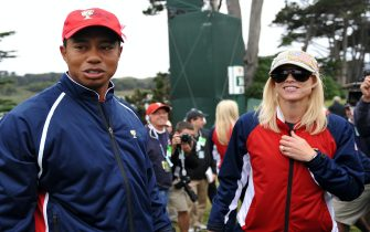 US team member Tiger Woods and his wife Elin Nordegren (R) wait for the rest of the team to finish play after Woods sunk his putt on the 13th green to win his match and clinch the cup win for the US in the Presidents Cup golf competition on October 11, 2009 at Harding Park Golf course in San Francisco.         AFP PHOTO/ROBYN BECK (Photo credit should read ROBYN BECK/AFP via Getty Images)