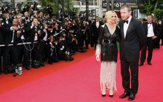 "US singer Madonna and her husband Guy Ritchie arrive to attend the screening of US director Steven Soderbergh's film 'Che' at the 61st Cannes International Film Festival on May 21, 2008 in Cannes, southern France. The May 14-25 festival winds up with the awards ceremony for the prestigious Palme d'Or, to be determined by a jury headed by Hollywood ""bad boy"" Sean Penn.      AFP PHOTO / FRANCOIS GUILLOT        (Photo credit should read FRANCOIS GUILLOT/AFP/GettyImages)"
