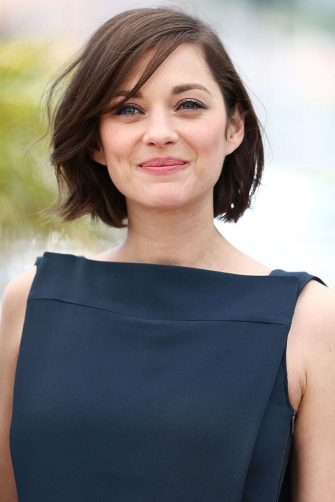 CANNES, FRANCE - MAY 20:  Actress Marion Cotillard attends the photocall for 'Blood Ties' at The 66th Annual Cannes Film Festival on May 20, 2013 in Cannes, France.  (Photo by Andreas Rentz/Getty Images)