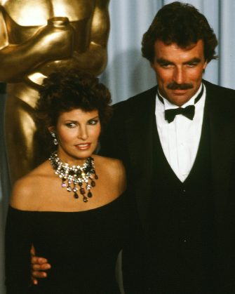 LOS ANGELES,CA - APRIL 11, 1983: Actress Raquel Welch poses with actor Tom Selleck backstage during the 55th Academy Awards at Dorothy Chandler Pavilion, Los Angeles, California. (Photo by Michael Montfort/Michael Ochs Archives/Getty Images)