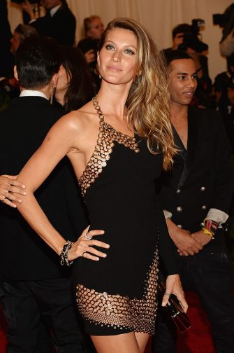 """NEW YORK, NY - MAY 06:  Gisele Bundchen attends the Costume Institute Gala for the """"PUNK: Chaos to Couture"""" exhibition at the Metropolitan Museum of Art on May 6, 2013 in New York City.  (Photo by Dimitrios Kambouris/Getty Images)"""