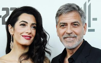 epa09167186 (FILE) - US actor and director George Clooney (R) with his wife Lebanese-British barrister Amal Clooney (L) arrive for the premiere of 'Catch 22' in London, Britain, 15 May 2019 (reissued 29 April 2021). George Clooney turns 60 on 06 May 2021.  EPA/ANDY RAIN