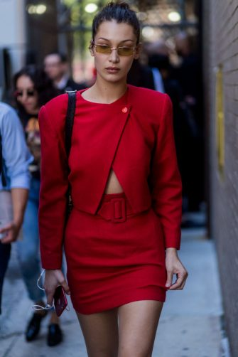 NEW YORK, NY - SEPTEMBER 13: Bella Hadid wearing red skirt and red jacket seen in the streets of Manhattan outside Michael Kors during New York Fashion Week on September 13, 2017 in New York City. (Photo by Christian Vierig/Getty Images)