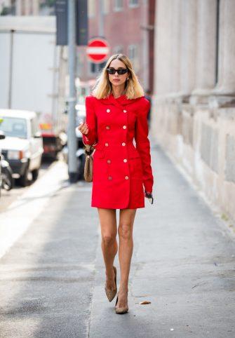MILAN, ITALY - JUNE 15: Candela Novembre is seen wearing red coat outside M1992 during the Milan Men's Fashion Week Spring/Summer 2020 on June 15, 2019 in Milan, Italy. (Photo by Christian Vierig/Getty Images)