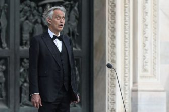 This photo taken on April 12, 2020 shows Italian tenor and opera singer Andrea Bocelli sing during a rehearsal on a deserted Piazza del Duomo in central Milan, prior to an evening performance without public for the world wounded by the pandemic, during the country's lockdown aimed at curbing the spread of the COVID-19 infection, caused by the novel coronavirus. - Famous Italian tenor Andrea Bocelli said on May 26, 2020 that he was contaminated at the beginning of March by a mild form of COVID-19. (Photo by Piero Cruciatti / AFP) (Photo by PIERO CRUCIATTI/AFP via Getty Images)