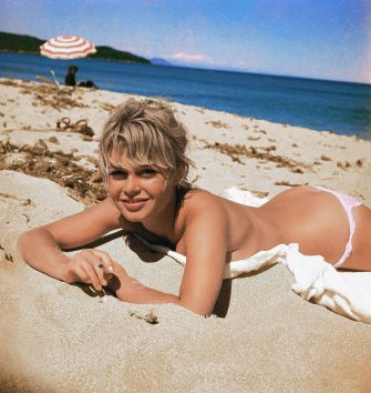 (Original Caption) Brigitte Bardot, originally Camille Javal, actress, pictured here on a towel, sunning on the beach.