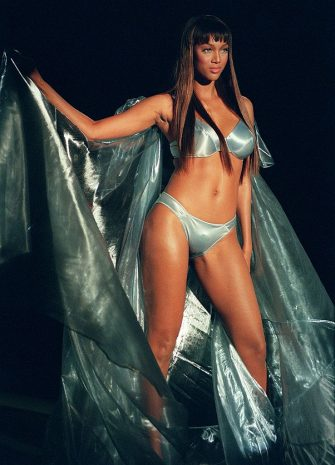 NEW YORK, UNITED STATES:  US model Tyra Banks wears a sheer organza cape over a satin bra and bikini during the Victoria's Secret Spring Fashion show 03 February in New York. The show was web-cast as of 7:15 pm ET 03 February.   AFP PHOTO Stan HONDA (Photo credit should read STAN HONDA/AFP via Getty Images)