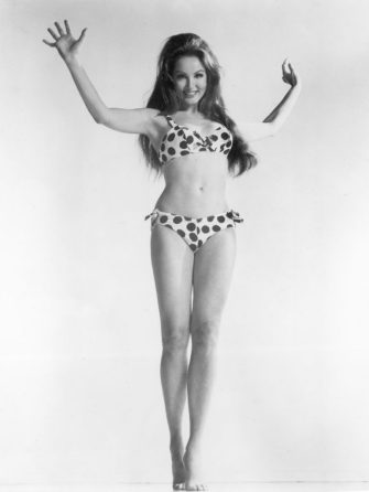 Full-length portrait of American actor Julie Newmar wearing a polka dotted bikini, 1960s. (Photo by Hulton Archive/Getty Images)