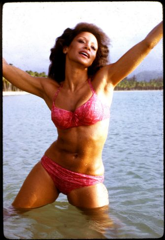 Portrait of American singer and actress Freda Payne, dressed in a bikini, as she stands in the water, her arms in the air, Puerto Rico, 1980s. (Photo by Anthony Barboza/Getty Images)