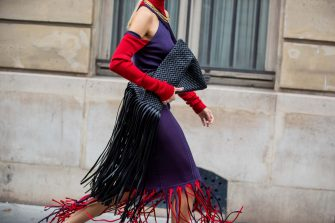 PARIS, FRANCE - OCTOBER 08: Leonie Hanne is seen wearing purple red dress with fringes Bottega Veneta and bag with fringes during a Street Style Fashion Photo Session on October 08, 2020 in Paris, France. (Photo by Christian Vierig/Getty Images)