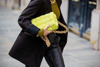 PARIS, FRANCE - OCTOBER 08: Leonie Hanne is seen wearing black blazer Maison Margiela, neon yellow bag Bottega Veneta, shorts Bottega, green turtleneck during a Street Style Fashion Photo Session on October 08, 2020 in Paris, France. (Photo by Christian Vierig/Getty Images)