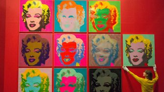 LONDON, UNITED KINGDOM - FEBRUARY 10:  Museum staff makes final adjustments to a selection of ten colour Andy Warhol screen prints featuring Marilyn Monroe installed in the British Museums Sainsburys exhibition gallery in London, United Kingdom on February 10, 2017. The prints are part of the museums Spring headline exhibition The American Dream: Pop to the present.  (Photo by Ray Tang/Anadolu Agency/Getty Images)