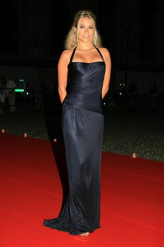 """MILAN, ITALY - JULY 15: Martina Stella arrives  at the dinner at Palazzo Reale, after the ballet """"Thanks Gianni with Love"""" to commemorate the tenth anniversary of the death of Italian stylist Gianni Versace July 15, 2007 in Milan, Italy. (Photo by Giuseppe Cacace /Getty Images)"""
