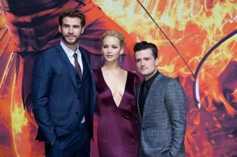 BERLIN, GERMANY - NOVEMBER 04:  Liam Hemsworth; Jennifer Lawrence and Josh Hutcherson attends the world premiere of the film 'The Hunger Games: Mockingjay - Part 2' at CineStar on November 4, 2015 in Berlin, Germany.  (Photo by Luca Teuchmann/WireImage)