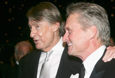 BANGKOK, THAILAND - JANUARY 21:  Director Joel Schumacher (L) arrives with Actor Michael Douglas at the 2005 Golden Kinnaree Awards for the Bangkok International Film Festival at the Queen Sirikit Convention January 21, 2005 in Bangkok, Thailand. (Photo by Patrick Riviere/Getty Images)