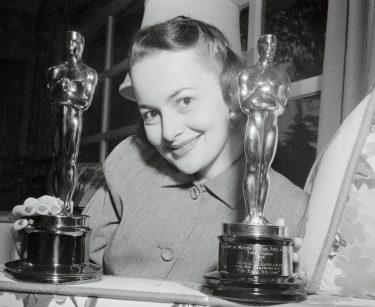 1950-Portrait of Actress Olivia De Haviland and the OScars that she has won.