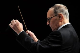 MILAN, ITALY - DECEMBER 01:  Italian composer and conductor Ennio Morricone performs with his orchestra at Arcimboldi Theatre on December 1, 2009 in Milan, Italy.  (Photo by Morena Brengola/Getty Images)