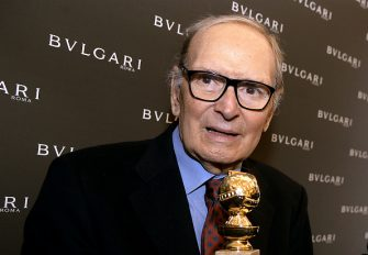 "Italian orchestrator and conductor, Ennio Morricone poses with the 2016 Golden Globe for Best Original Score for Quentin Tarantinos hit movie ""The Hateful Eight"" during a press conference at Bulgari Domus in central Rome on January 30, 2016.   One of the highlights of the Golden Globe handing over ceremony was the announcement of Bulgaris support of The Glance of Music, a documentary Tornatore is in the process of filming as a tribute to Morricone, a pillar of the world of music as well as his friend and long time cinematic and musical collaborator of almost 25 years. / AFP / FILIPPO MONTEFORTE        (Photo credit should read FILIPPO MONTEFORTE/AFP via Getty Images)"