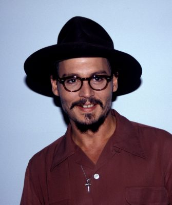 JOHNNY DEPPJanuary 2006Ref: AWheadshot portrait glasses black hat goatee mustache gold teethwww.capitalpictures.comsales@capitalpictures.com© Capital Pictures