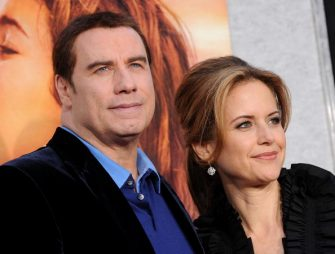 """LOS ANGELES, CA - MARCH 25:  Actor John Travolta (L) and actress Kelly Preston arrive at the premiere of Touchstone Picture's """"The Last Song"""" held at ArcLight Hollywood on March 25, 2010 in Los Angeles, California.  (Photo by Kevin Winter/Getty Images)"""