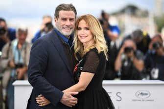 """TOPSHOT - US actor John Travolta (L) and his wife US actress Kelly Preston pose on May 15, 2018 during a photocall for the film """"Gotti"""" at the 71st edition of the Cannes Film Festival in Cannes, southern France. (Photo by Anne-Christine POUJOULAT / AFP)        (Photo credit should read ANNE-CHRISTINE POUJOULAT/AFP via Getty Images)"""
