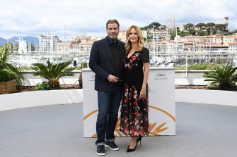 """US actor John Travolta (L) and his wife US actress Kelly Preston pose on May 15, 2018 during a photocall for the film """"Gotti"""" at the 71st edition of the Cannes Film Festival in Cannes, southern France. (Photo by Anne-Christine POUJOULAT / AFP)        (Photo credit should read ANNE-CHRISTINE POUJOULAT/AFP via Getty Images)"""