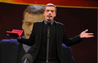 BERLIN, GERMANY - FEBRUARY 29: Cristi Puiu winner of the Best Director in the 'Encounters' Competition for the movie 'Malmkrog' on stage at the closing ceremony of the 70th Berlinale International Film Festival Berlin at Berlinale Palace on February 29, 2020 in Berlin, Germany. (Photo by Andreas Rentz/Getty Images)