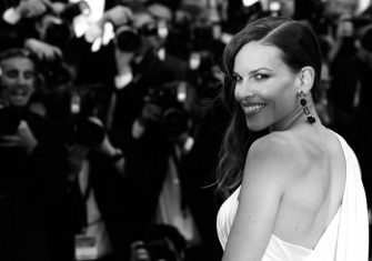 """BLACK AND WHITE VERSION US actress Hilary Swank poses as she arrives for the screening of the film """"The Homesman"""" at the 67th edition of the Cannes Film Festival in Cannes, southern France, on May 18, 2014. AFP PHOTO / LOIC VENANCE        (Photo credit should read LOIC VENANCE/AFP via Getty Images)"""