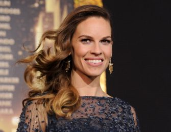 """HOLLYWOOD, CA - DECEMBER 05:  Actress Hilary Swank arrives at the premiere of Warner Bros. Pictures' """"New Year's Eve"""" at Grauman's Chinese Theatre on December 5, 2011 in Hollywood, California.  (Photo by Kevin Winter/Getty Images)"""