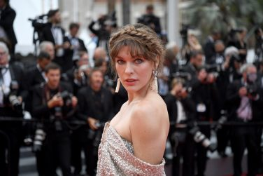 """US actress Milla Jovovich arrives for the screening of the film """"Sibyl"""" at the 72nd edition of the Cannes Film Festival in Cannes, southern France, on May 24, 2019. (Photo by CHRISTOPHE SIMON / AFP) (Photo by CHRISTOPHE SIMON/AFP via Getty Images)"""